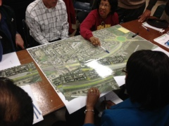 Attendees discuss one option for the new Southeast Boulevard.