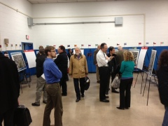Meeting attendees discuss potential options for improving safety at the Penn-Potomac intersection.