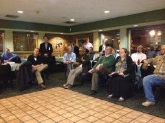 Attendees listen to a presentation about plans for a residential building at 1550 Penn Ave SE.